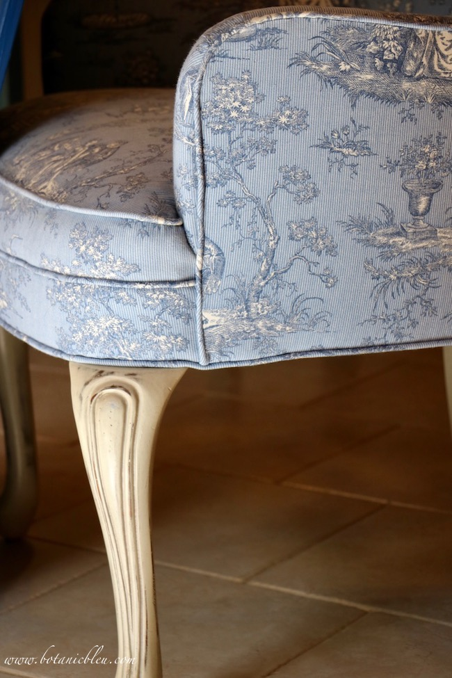 Add French Country style to a room by reupholstering a chair in blue and white toile