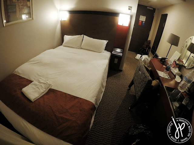 hotel room with bed, desk, chair