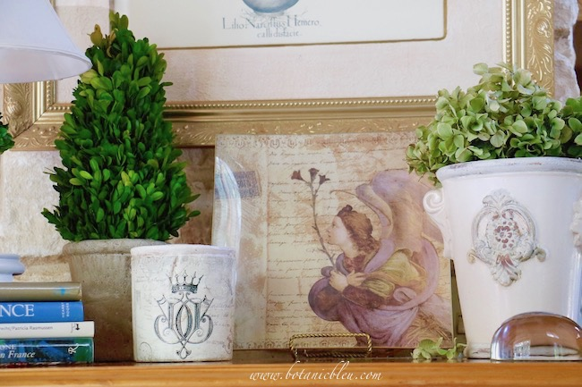 Create a fall vignette using unusual french medieval angel print on a pine chest