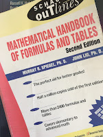 Mathematical Handbook for Formulas and Tables, superimposed on Intermediate Physics for Medicine and Biology.