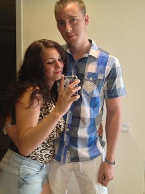 Two people taking a mirror photo