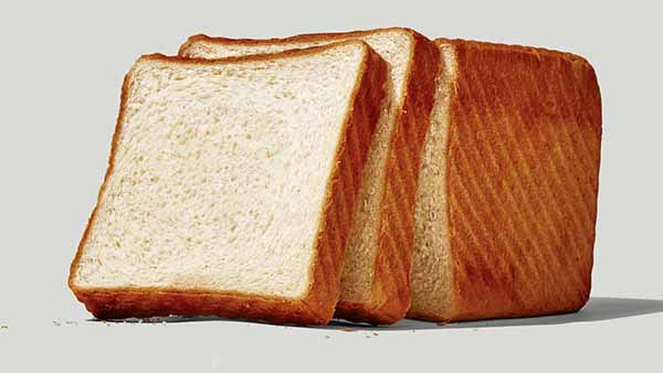 Slices of bread from a full bread
