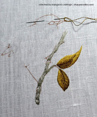 Completed thread painted leaves in golds and browns