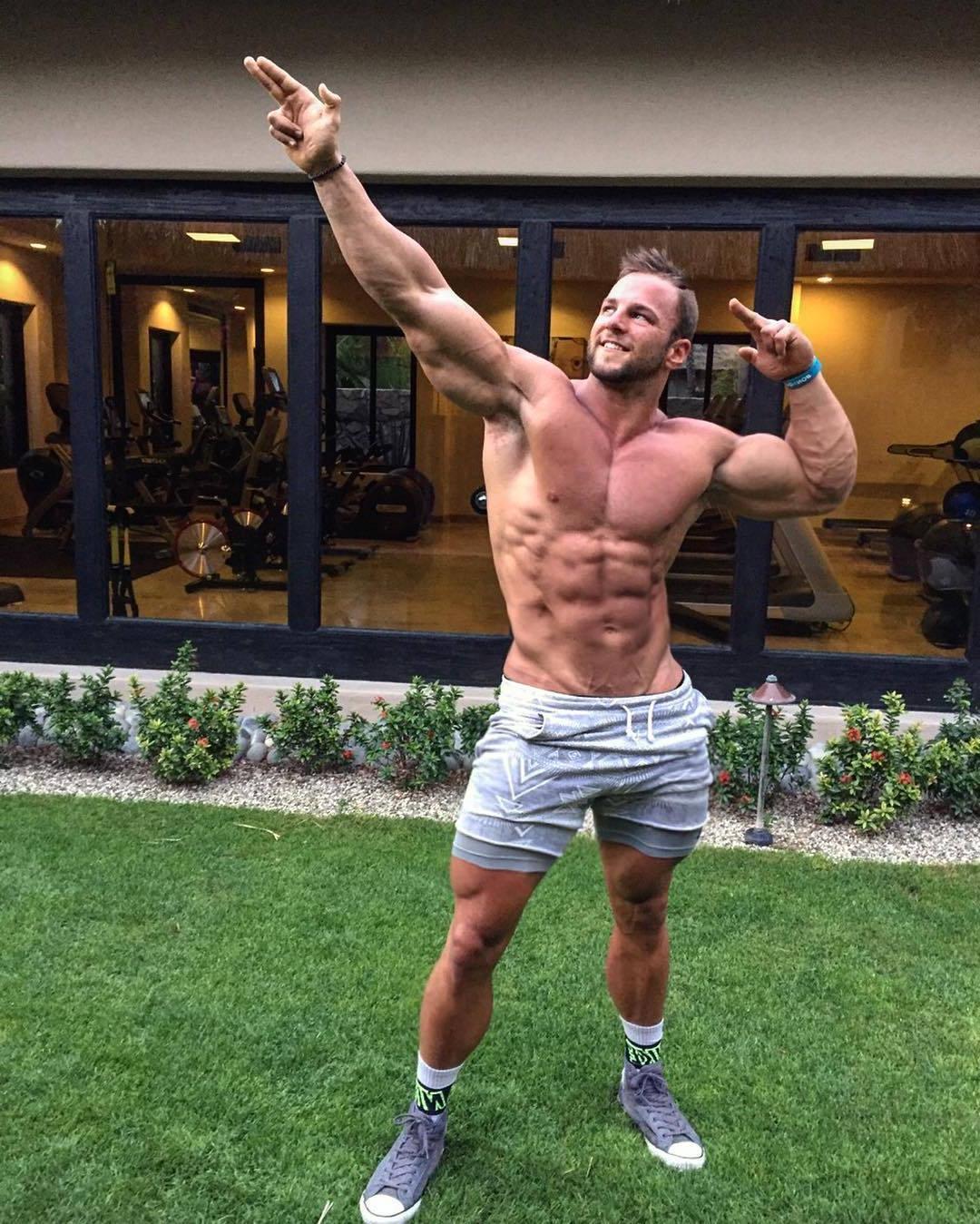 cocky-muscular-dads-eric-janicki-shirtless-biceps-flex