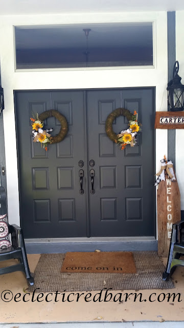 Decorated Front Doors. Share Now. #wreaths #sunflowers #fallwreaths #eclecticredbarn
