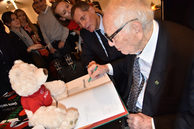 I'm with great Pierre Cardin who signed a book for Runway Magazine.