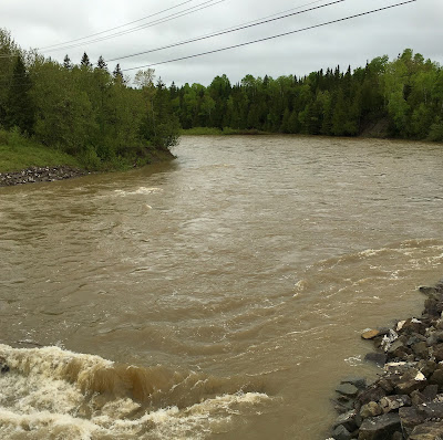The crystal clear St. Jean River was a muddy torrent. Gaspe