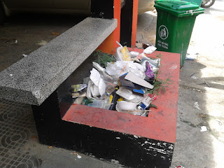 Picture of trash piling up in box planter at the old Equinox in Phnom Penh Cambodia