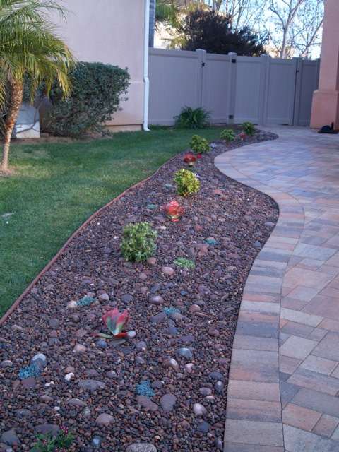 Paver Driveway Planting And Gravel As Mulch
