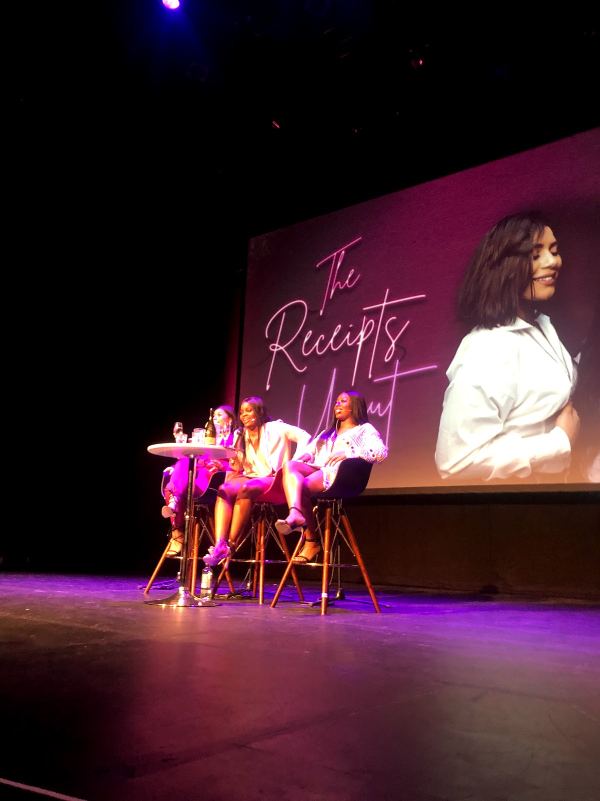 A shot of Milena, Aubrey and Tolly on stage at the Reciepts podcast live tour in Manchester HOME theatre
