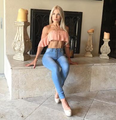 Ingrid Romero sitting down in a pair of blue jean trouser