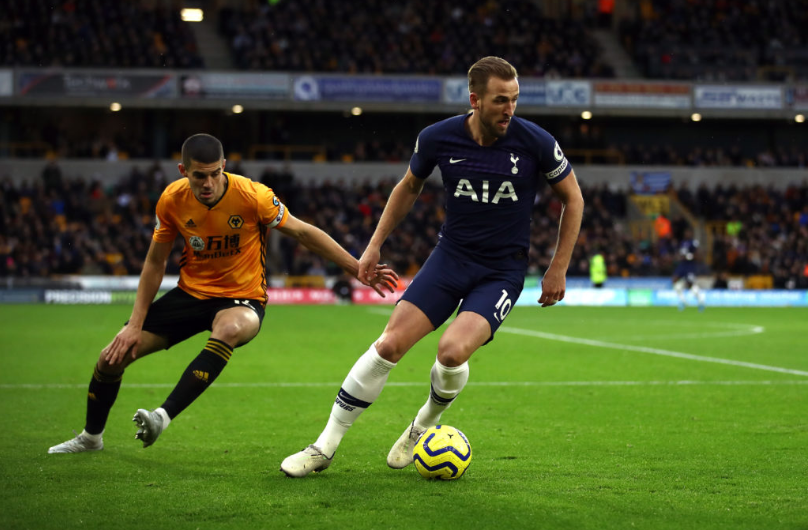 Kane gets away from Wolves' captain Conor Coady during EPL clash
