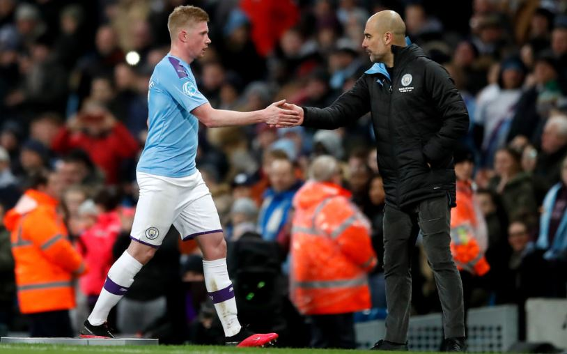 Manchester City's Kevin De Bruyne and manager Pep Guardiola