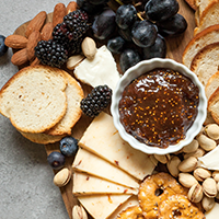 Cheese board with fruit and chutney - Food