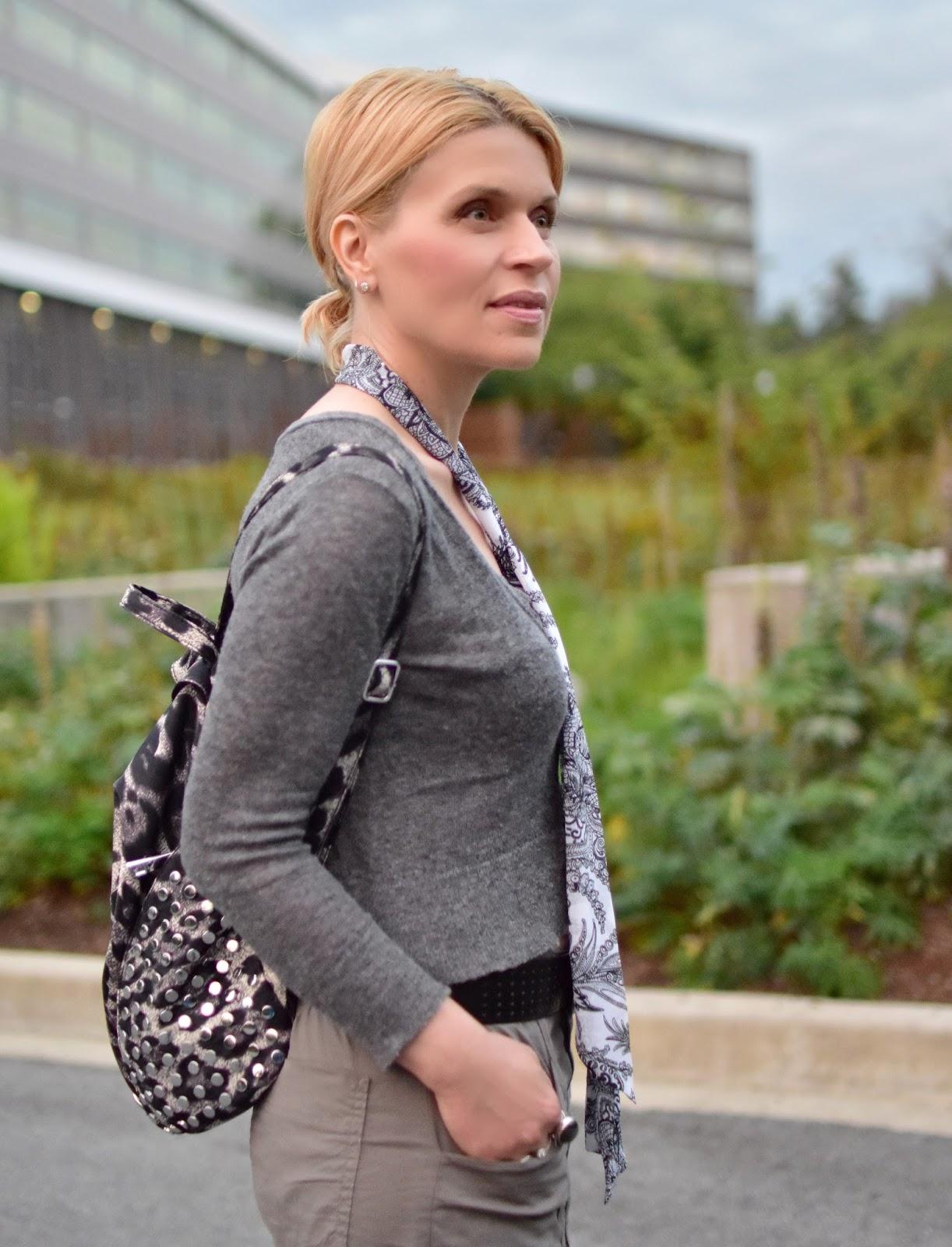 shrunken cardigan, leopard-patterned backpack, skinny paisley scarf