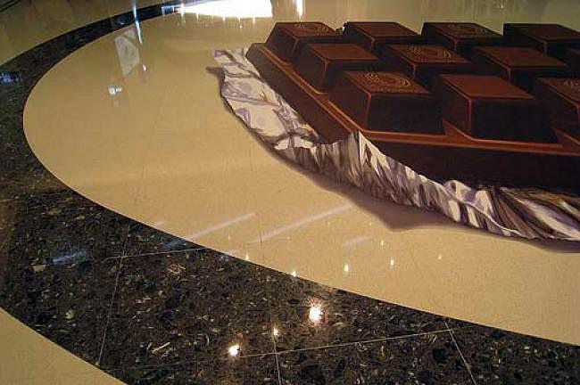 Alüminyum kağıdı üzerinde bir çikolata gösteren kaldırım sanatı resmi