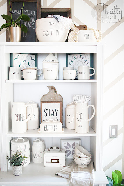 white cabinet with rae dunn collection