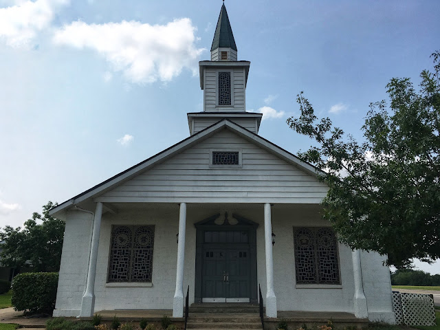 white wooden church in small town texas