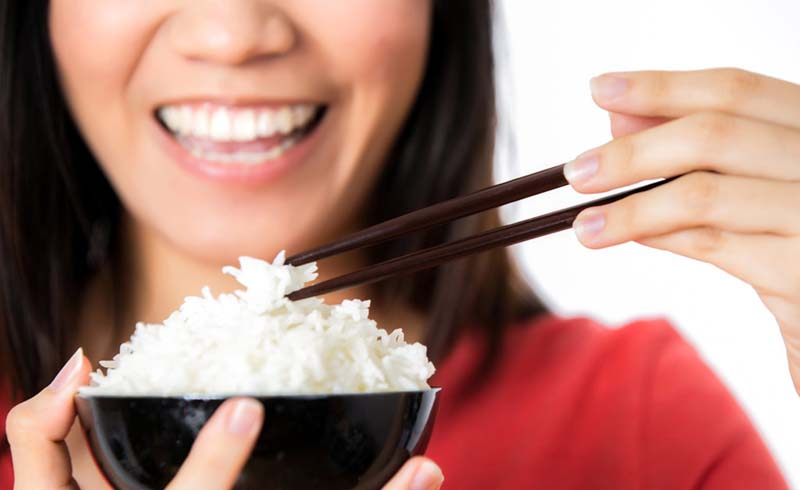 A cooking hack slashes calories in rice by nearly a half.