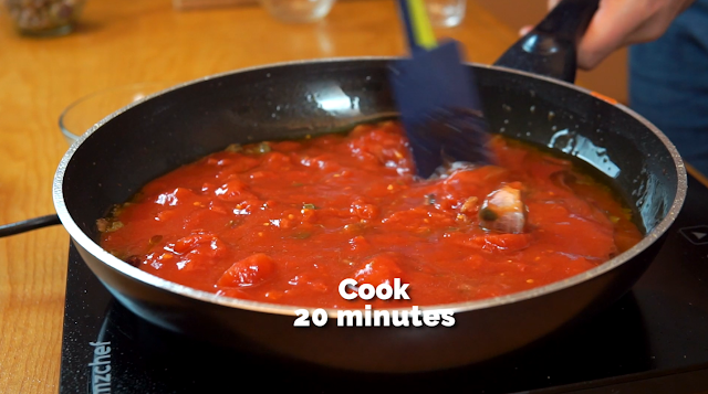 making the puttanesca sauce