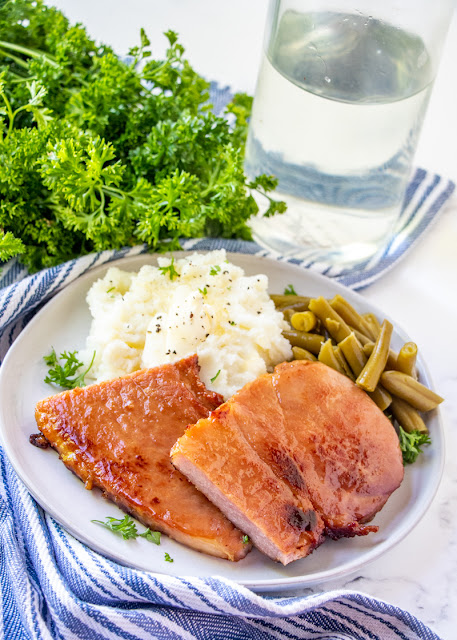 This old fashioned easy and tasty ham steak is great for breakfast or dinner! The brown sugar and butter combo makes a delicious sauce that goes perfectly with the salty taste of ham. This family favorite recipe is sure to be a hit!