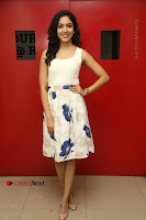 Actress Ritu Varma Stills in White Floral Short Dress at Kesava Movie Success Meet .COM 0029.JPG