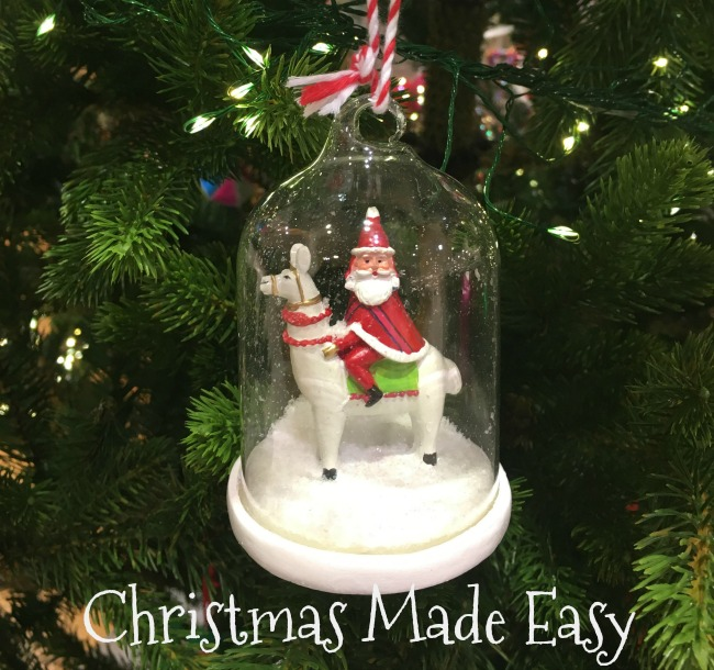 christmas-made-easy-text-under-image-of-santa-riding-a-llama-tree-decoration