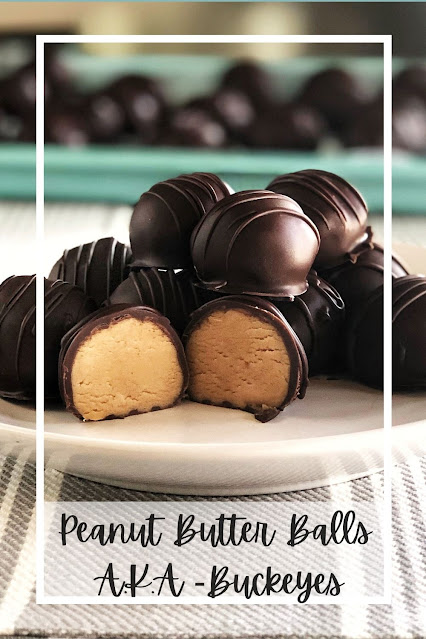 chocolate covered peanut butter balls on a white plate