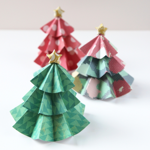 Diy Paper Christmas Trees Topped With Origami Stars.