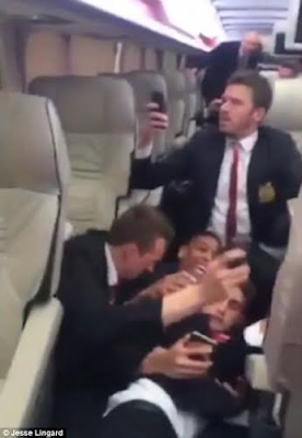 Manchester United players inside their team bus as they were being attacked by west ham supporters