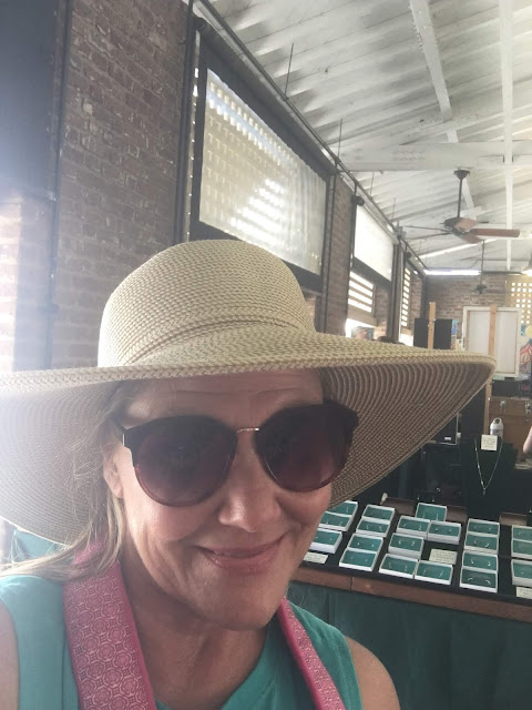 Trying on hats in The Market
