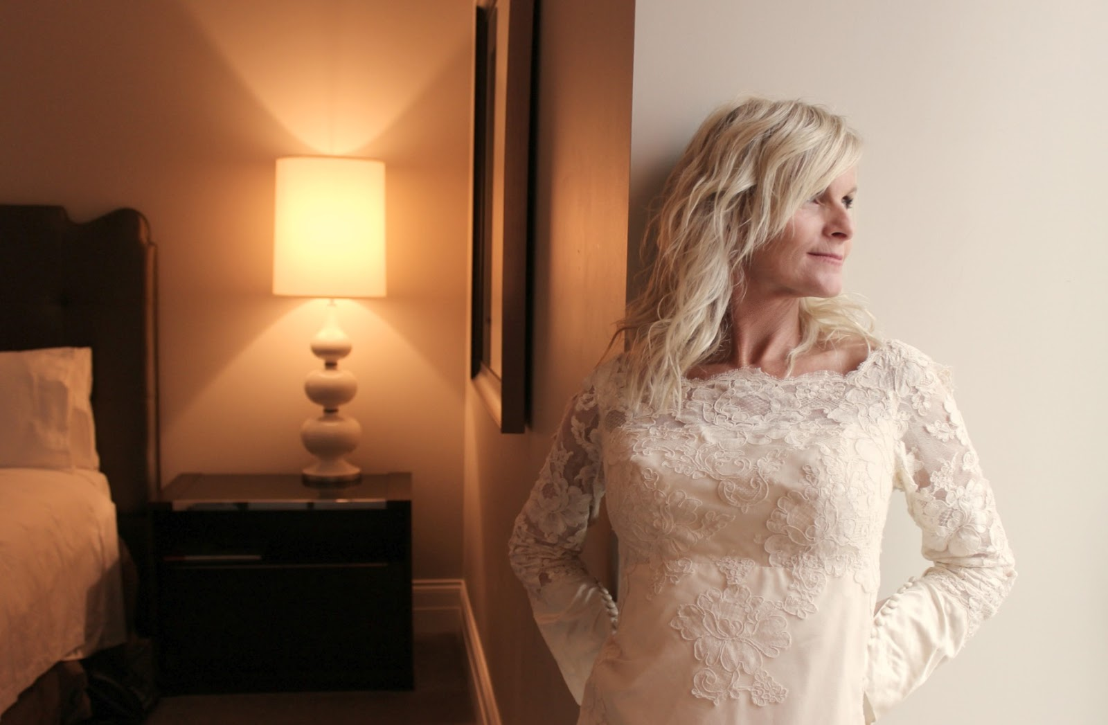 Michele in 1960s lace wedding gown in guest room Waldorf Chicago Hello Lovely Studio