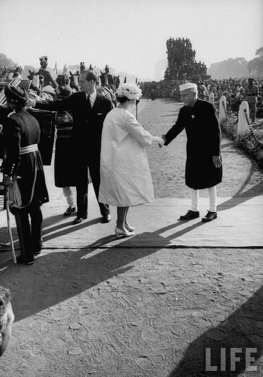 Jawaharlal Nehru greeting Queen Elizabeth II and Prince Philip.