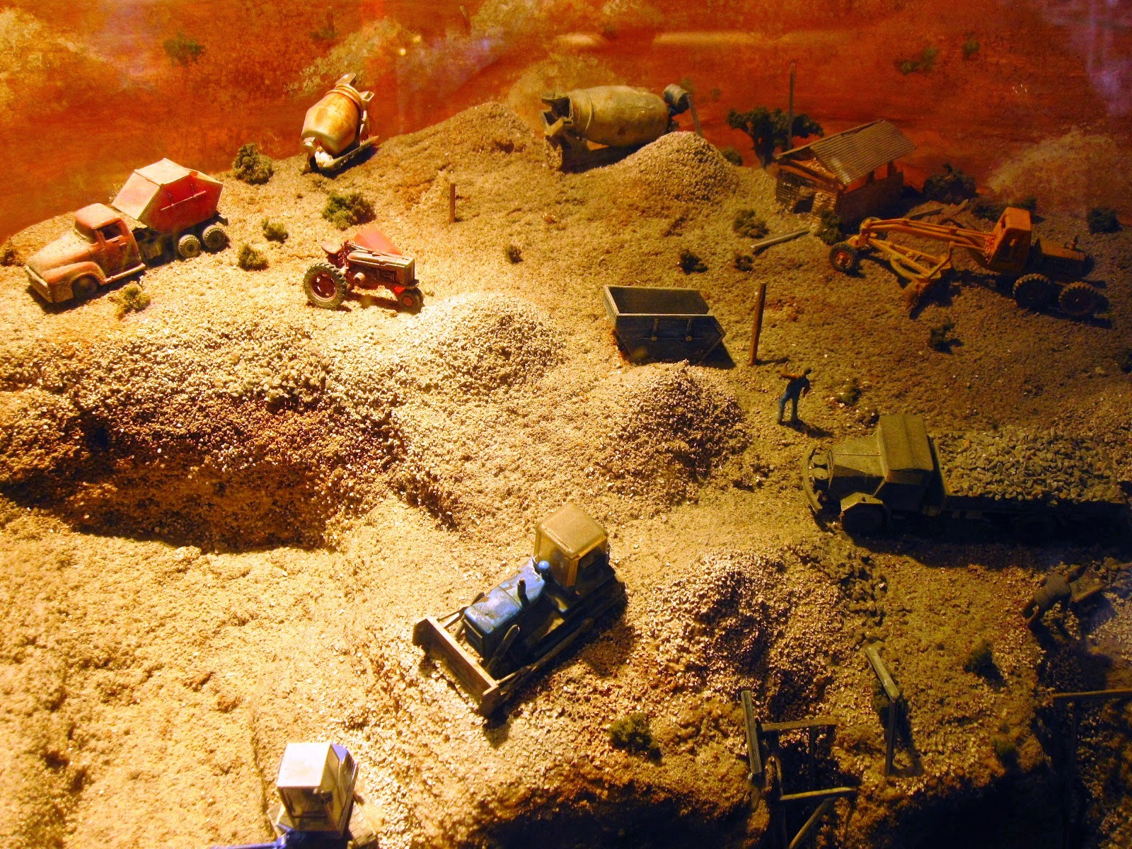 Scale model of an opal mine in a shop window.