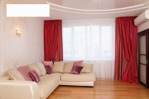 Red Curtains and Window treatments in the interiors living room - red curtains for living room