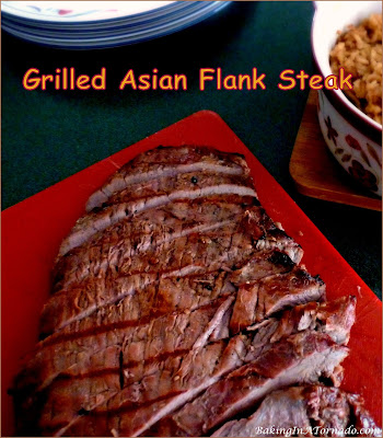 Grilled Asian Flank Steak is bursting with flavor. Marinate up to 48 hours, grill, slice and serve a new warm weather dinner favorite. | Recipe developed by www.BakingInATornado.com | #recipe #dinner