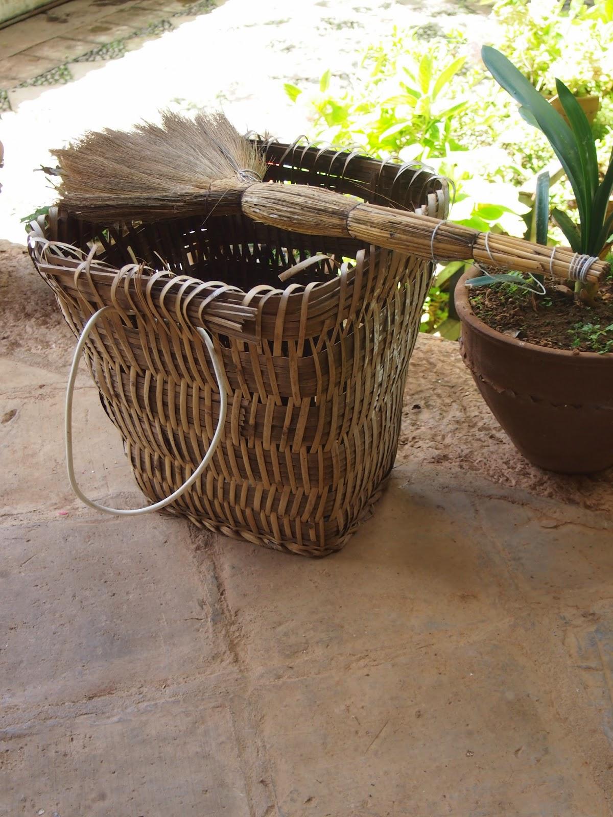 a broom and basket