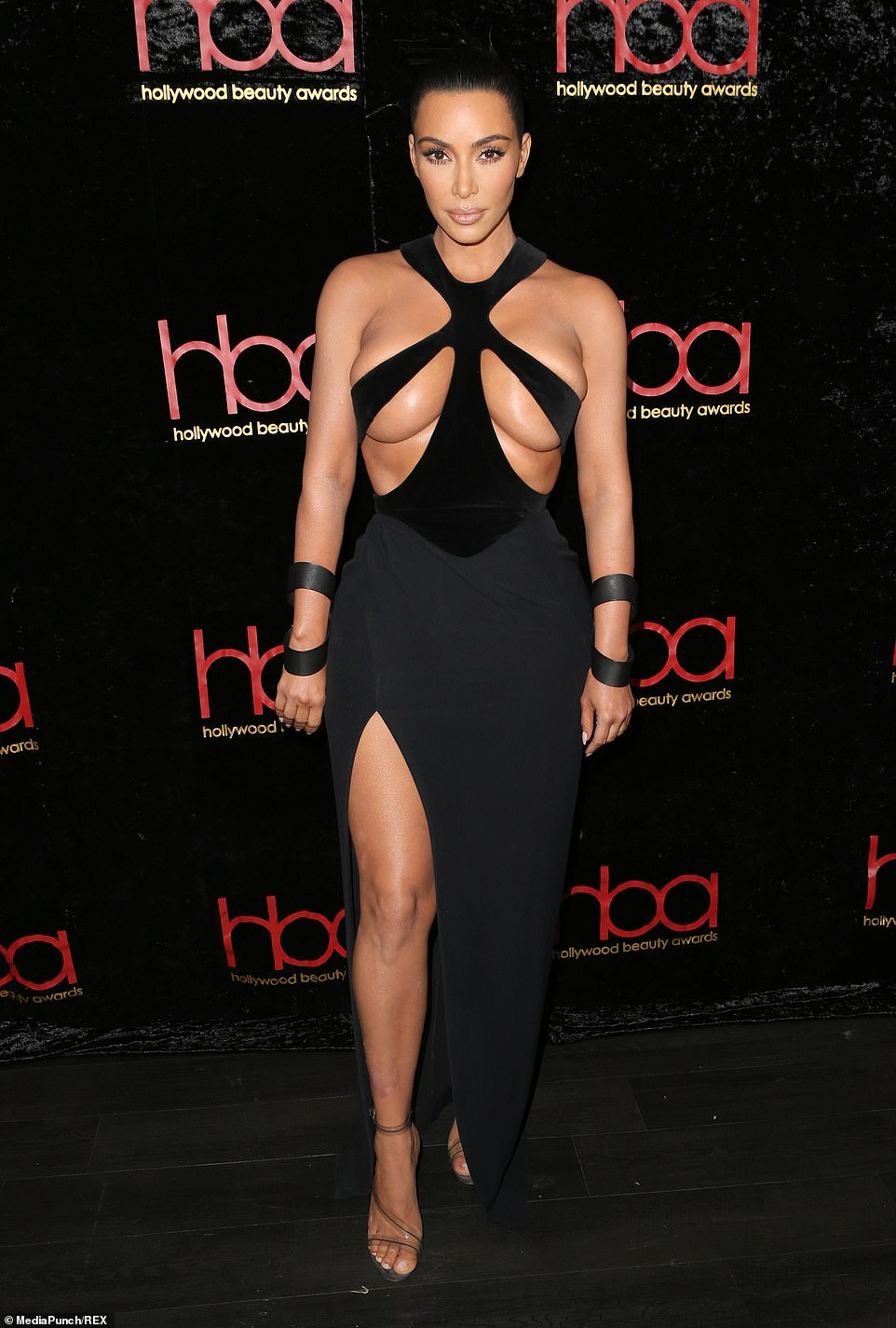 Kim Kardashian Risks Wardrobe Malfunction In Black Dress That Barely Covers Her Nipples