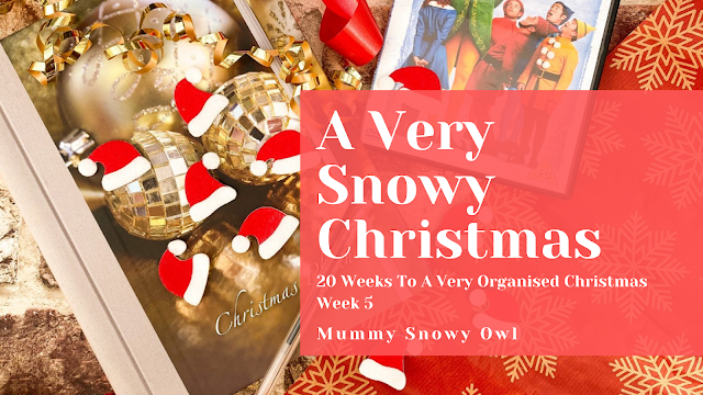 A festive flat lay with the text a Very Snowy Christmas over the top