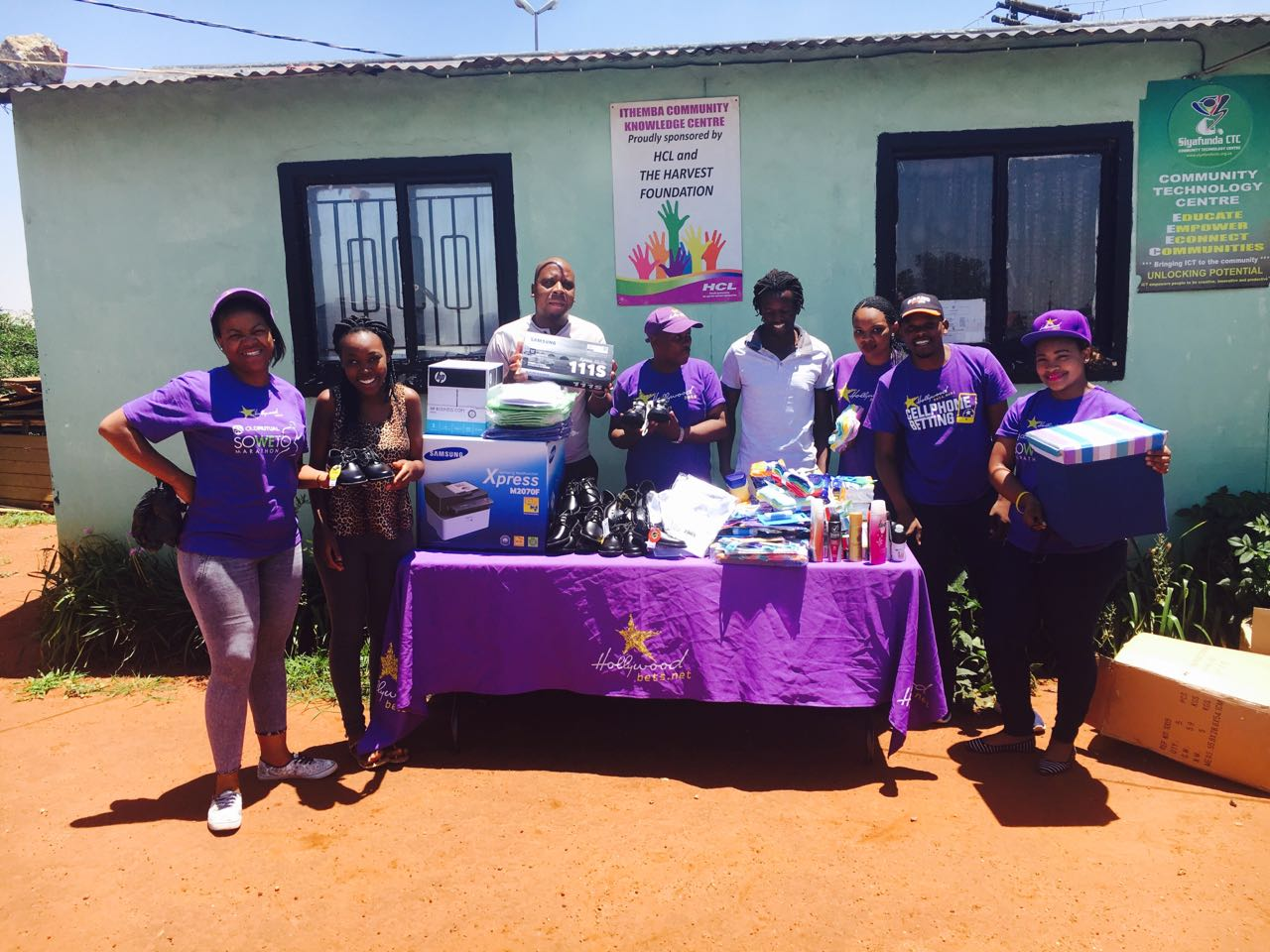 Ithemba Community Centre staff members were happy to receive a donation of school shoes, a printer and other essential items from Hollywoodbets Kempton Park