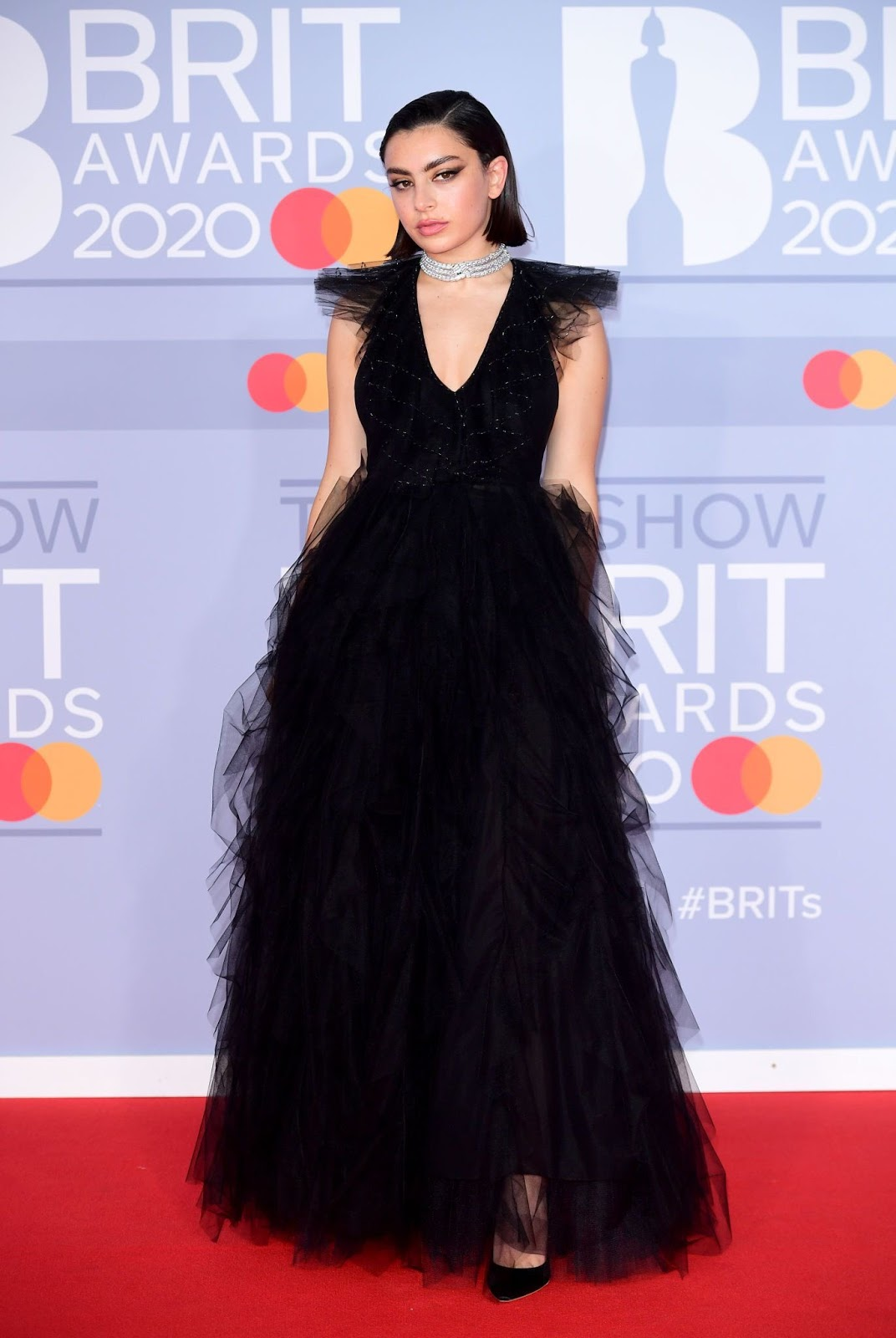 Charli XCX oozes Gothic chic in a black tulle gown as hits the red carpet following British Female Solo Artist nomination