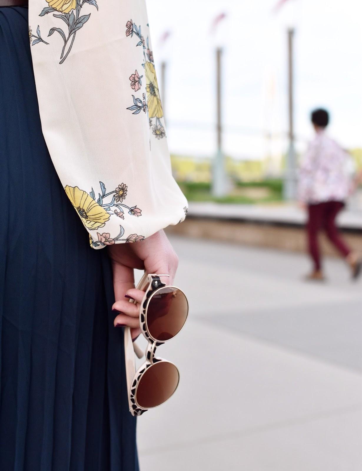 Monika Faulkner outfit inspiration - pleated maxi skirt, floral blouse, corset belt, Nanette animal-patterned sunglasses