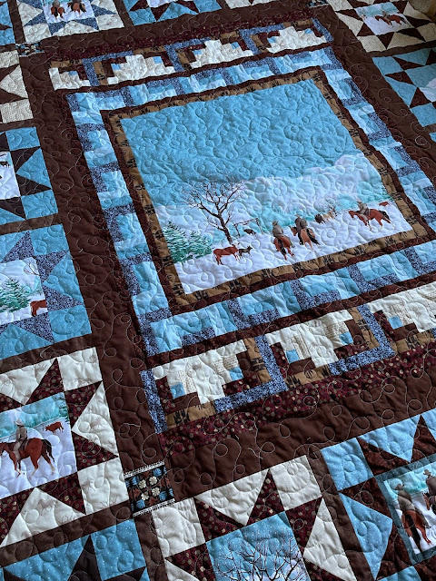 Angled shot of center of quilt showing meander quilting