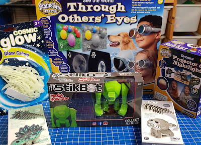 Brainstorm STEM toys for Christmas arranged on table including dinosaurs stars stikbots