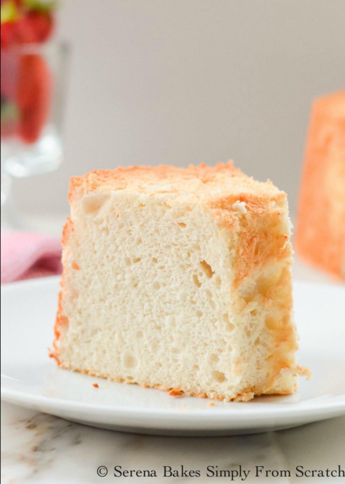Angel Food Cake recipe from scratch is a light airy and delicious cake recipe perfect with strawberries from Serena Bakes Simply From Scratch.