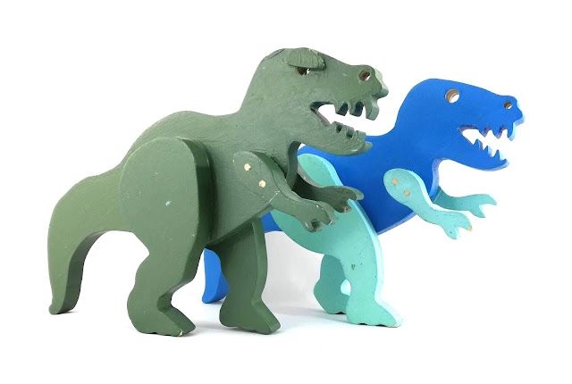 Handmade Wooden Toy Dinosaurs Showing Battle Scars and Repairs by The Toy Shop Vet