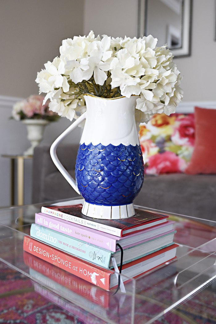 Blue and white fish pitcher vase with faux white hydrangeas + Tips for shopping for home decor at antique and thrift stores. | via monicawantsit.com