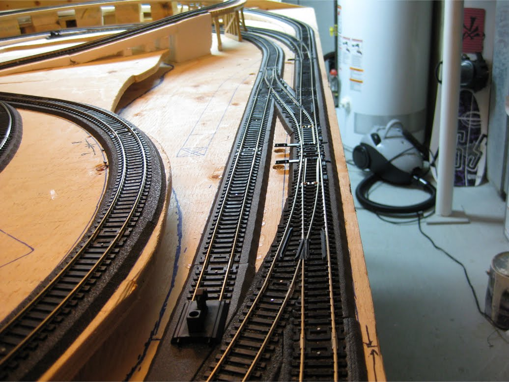 4 installed Atlas turnouts at the front of a model railroad layout staging area