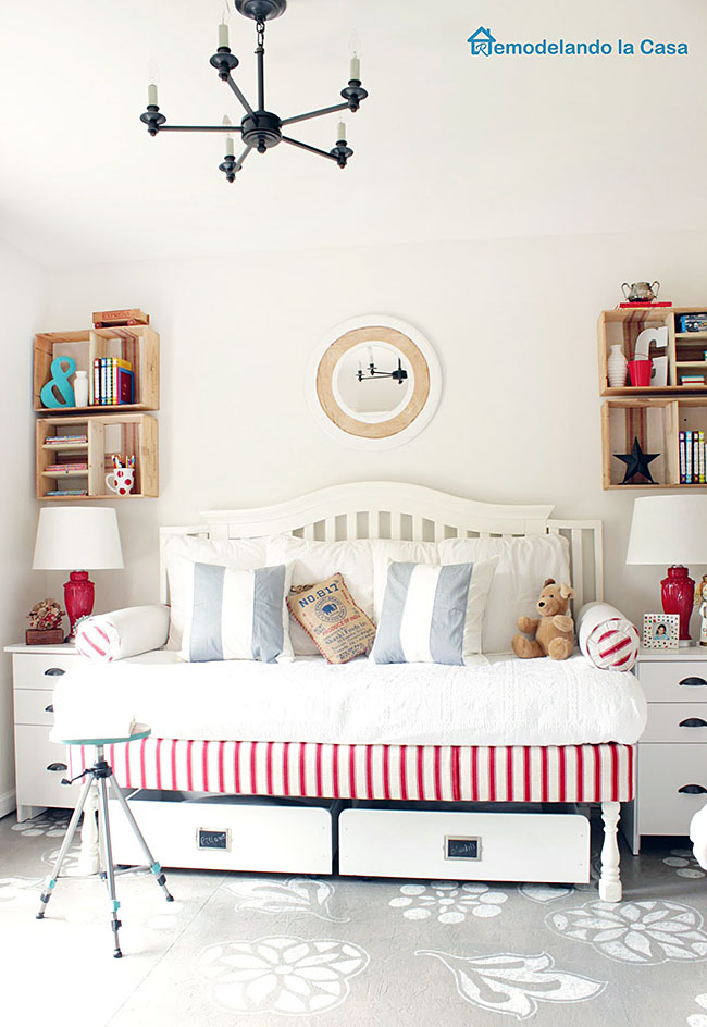 red and white guest bedroom with designs on the floor