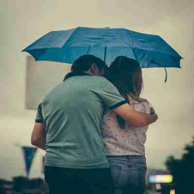 two lovers under an umbrella
